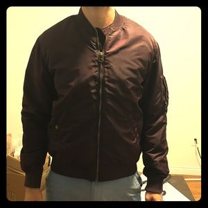 Maroon colored bomber jacket
